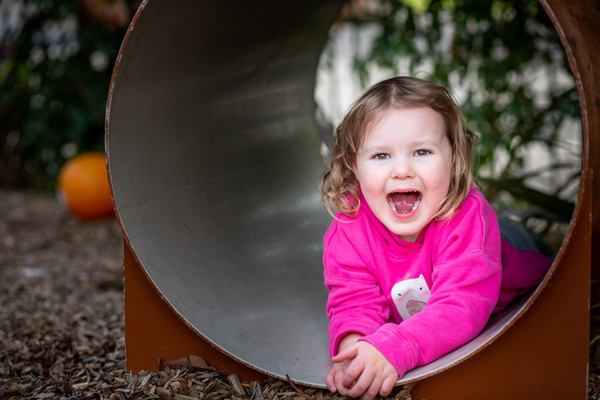 Girl playing in tunnel at King Kids