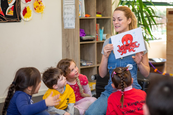 Jumparoo Lady reading to Children at KingKids Childcare